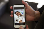 Deb Ware shows a photo she took of her son, Sam, 22, on life support from an overdose, in Fountaindale, Central Coast, Australia, Thursday, July 18, 2019. This was hardly the first overdose Sam had experienced since his addiction to pharmaceutical opioids began following a simple wisdom tooth extraction. But she wondered if it would be his last. He had somehow survived more than 60 overdoses in 12 months. (AP Photo/David Goldman)