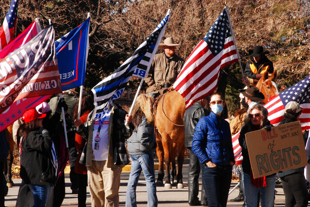 Supporters of President Donald Trump gather at the Statehouse in Santa Fe, N.M., on Wednesday, Jan. 6, 2021, to protest President-elect Joe Biden's electoral victory. (AP Photo/Morgan Lee)