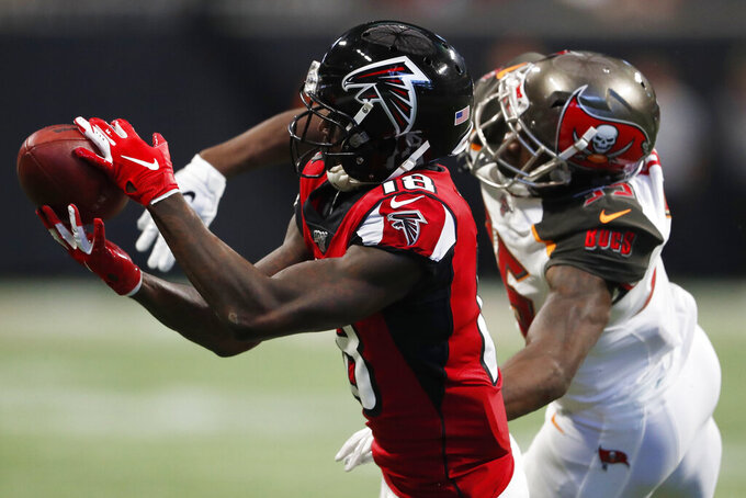 Atlanta Falcons wide receiver Calvin Ridley (18) misses the catch against Tampa Bay Buccaneers cornerback Carlton Davis (33) during the first half of an NFL football game, Sunday, Nov. 24, 2019, in Atlanta. (AP Photo/John Bazemore)