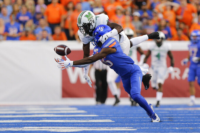 Boise State wide receiver John Hightower (16) and Marshall defensive back Jaylon McClain-Sapp go for pass during the first half of an NCAA college football game in Boise, Idaho, Friday, Sept. 6, 2019. (AP Photo/Otto Kitsinger)