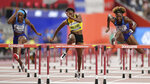 Nia Ali, of the United States, right, wins the gold medal in the women's 100 meter hurdles final at the World Athletics Championships in Doha, Qatar, Sunday, Oct. 6, 2019. At left is Kendra Harrison, of the United States, silver, and Danielle Williams, of Jamaica, bronze. (AP Photo/Petr David Josek)