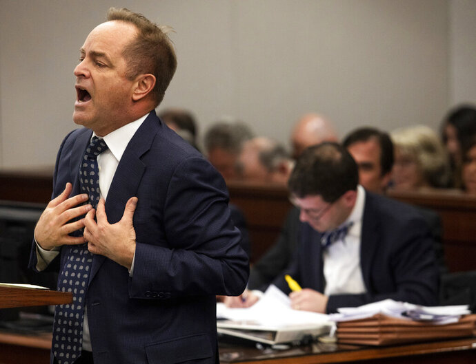 FILE - In this Feb. 6, 2019 file photo, Special prosecutor Todd Flood, left, speaks during a motion hearing at Genesee County Circuit Court in Flint, Mich. Flood, a special prosecutor who spent three years leading a criminal investigation of the Flint water scandal has been fired, officials announced Monday, April 29, 2019, apparently part of the fallout from the recent discovery of 23 boxes of records in the basement of a state building.(Kaiti Sullivan/The Flint Journal via AP File)