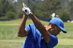Tiger Woods warms up at the driving range during a practice day for the U.S. Open Championship golf tournament Tuesday, June 11, 2019, in Pebble Beach, Calif. (AP Photo/David J. Phillip)