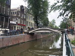 A steel 3D-printed pedestrian bridge spans a canal in the heart of the red light district in Amsterdam, Netherlands, Thursday, July 15, 2021. The distinctive flowing lines of the 12-meter (40-foot) bridge were created using a 3D printing technique called wire and arc additive manufacturing that combines robotics with welding. (AP Photo/Aleksandar Furtula)