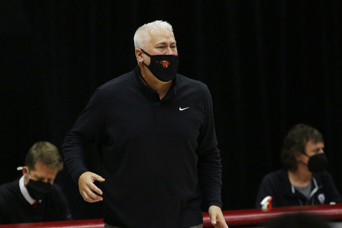 Oregon State coach Wayne Tinkle watches the team during the first half of an NCAA college basketball game against Washington State in Pullman, Wash., Wednesday, Dec. 2, 2020. (AP Photo/Young Kwak)
