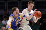 Pittsburgh guard Ryan Murphy (24) defends against Miami forward Sam Waardenburg during the first half of an NCAA college basketball game, Sunday, Jan. 12, 2020, in Coral Gables, Fla. (AP Photo/Lynne Sladky)