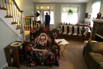In this Saturday, Feb. 23, 2019 photo, a Jerry Garcia blanket covers Greg Longenecker's chair at a home he shared, in Reading, Pa.  According to a civil rights lawsuit filed Monday, March 18, Pennsylvania State Police acted recklessly when troopers used a bulldozer to pursue the Grateful Dead fan caught growing marijuana on public land, killing him when he wound up under the machine's treads.  (AP Photo/Jacqueline Larma)