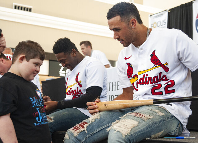 St. Louis Cardinals pitcher Jack Flaherty, right, talks with Brant Ballard, 15, before signing his baseball bat during the annual Cardinals Caravan event on Saturday, Jan. 18, 2020, in Jonesboro, Ark. (Quentin Winstine/The Jonesboro Sun via AP)