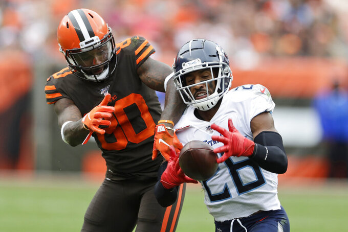 Tennessee Titans cornerback Logan Ryan (26) intercepts a throw intended for Cleveland Browns wide receiver Jarvis Landry (80) during the second half of an NFL football game Sunday, Sept. 8, 2019, in Cleveland. (AP Photo/Ron Schwane)