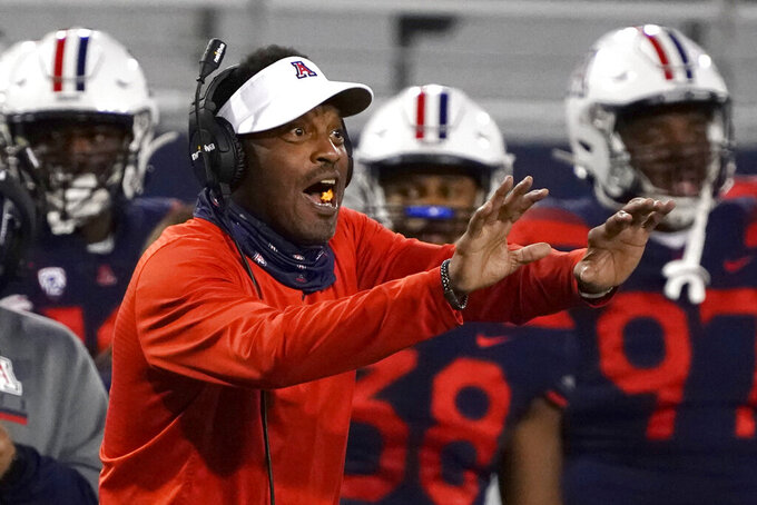 In this Friday, Dec. 11, 2020, photo, Arizona coach Kevin Sumlin reacts during the first half of the team's NCAA college football game against Arizona State in Tucson, Ariz. Arizona fired Sumlin on Saturday, Dec. 12, a day after a 70-7 loss to Arizona State extended the Wildcats' losing streak to a record 12 games over two seasons.(AP Photo/Rick Scuteri)