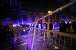 A protestor kicks a fence outside the Spanish Government Office in Barcelona, Spain, Tuesday, Oct. 15, 2019. Spain's Supreme Court on Monday convicted 12 former Catalan politicians and activists for their roles in a secession bid in 2017, a ruling that immediately inflamed independence supporters in the wealthy northeastern region. (AP Photo/Emilio Morenatti)