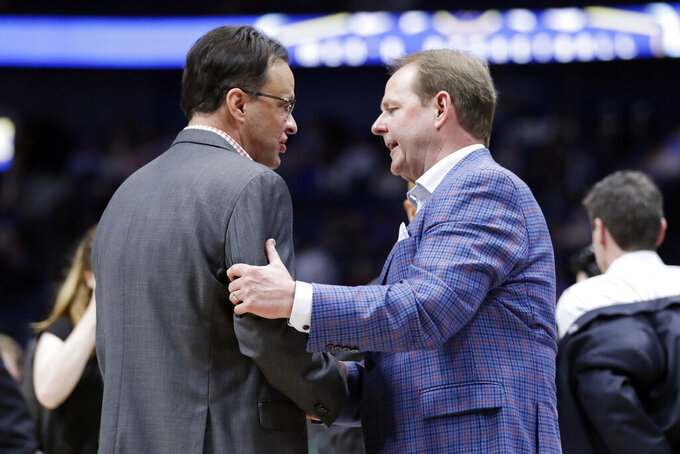 Georgia head coach Tom Crean, left, and Mississippi head coach Kermit Davis talk after an NCAA college basketball game in the Southeastern Conference Tournament Wednesday, March 11, 2020, in Nashville, Tenn. Georgia won 81-63. (AP Photo/Mark Humphrey)