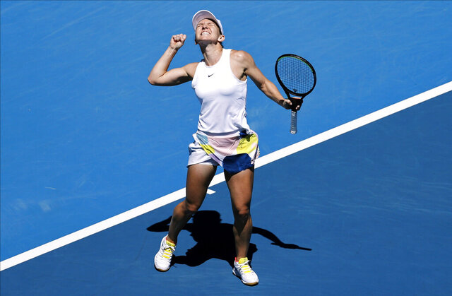 Romania's Simona Halep celebrates after defeating Estonia's Anett Kontaveit during their quarterfinal match at the Australian Open tennis championship in Melbourne, Australia, Wednesday, Jan. 29, 2020. (AP Photo/Dita Alangkara)