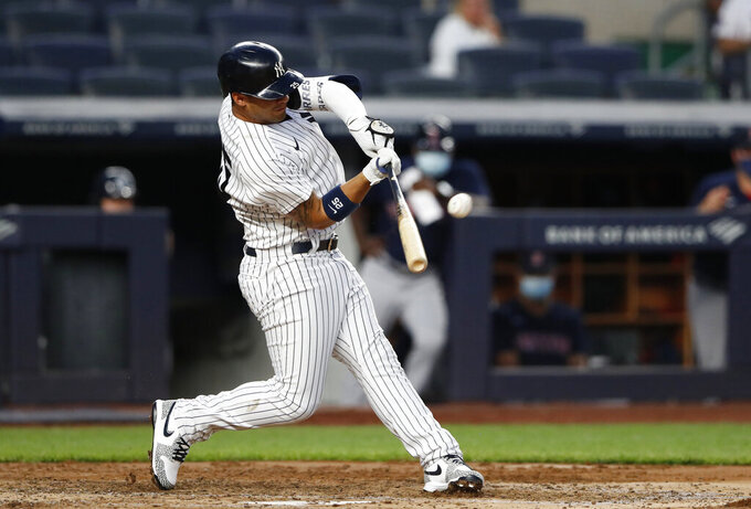New York Yankees' Gleyber Torres hits a home run in the fourth inning against the Boston Red Sox during a baseball game Saturday, June 5, 2021, in New York. (AP Photo/Noah K. Murray)