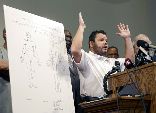 FILE - In this Aug. 18, 2014 file photo, Shawn Parcells speaks during a news conference in St. Louis County, Mo. Parcells, accused of performing illegal autopsies has been indicted on 10 counts of federal wire fraud. Parcells is a self-taught pathology assistant with no formal education. From 1996 to 2003, he worked as a pathology assistant for the Jackson County Medical Examiner's Office in Missouri.(AP Photo/Jeff Roberson File)