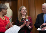 Rep. Jennifer Wexton, D-Va., center, flanked by Rep. Brenda Lawrence, D-Mich., left, and House Majority Leader Steny Hoyer, D-Md., right, applauds in recognition of the recent vote by the Virginia Senate and House of Delegates to ratify the Equal Rights Amendment, during an ERA event at the Capitol in Washington, Wednesday, Feb. 12, 2020. (AP Photo/J. Scott Applewhite)
