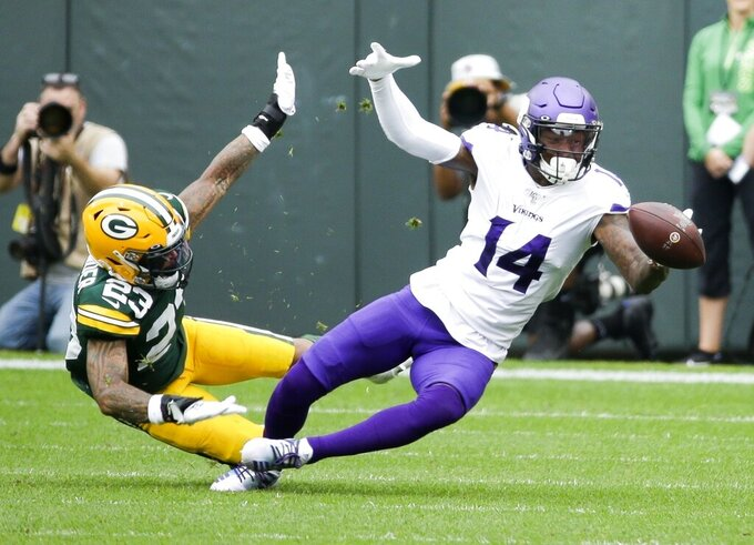 FILE - In this Sept. 15, 2019, file photo, Green Bay Packers' Jaire Alexander, left, breaks up a pass intended for Minnesota Vikings' Stefon Diggs during the first half of an NFL football game in Green Bay, Wis. Alexander believes his meditation sessions have helped him develop into one of the game's top young shutdown corners. (AP Photo/Mike Roemer, File)