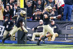 Purdue defensive end George Karlaftis (5) celebrates a touchdown on an interception against Wisconsin during the first half of an NCAA college football game in West Lafayette, Ind., Saturday, Oct. 23, 2021. (AP Photo/Michael Conroy)