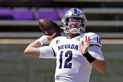 Nevada quarterback Carson Strong passes before an NCAA college football game against Kansas State Saturday, Sept. 18, 2021, in Manhattan, Kan. (AP Photo/Charlie Riedel)