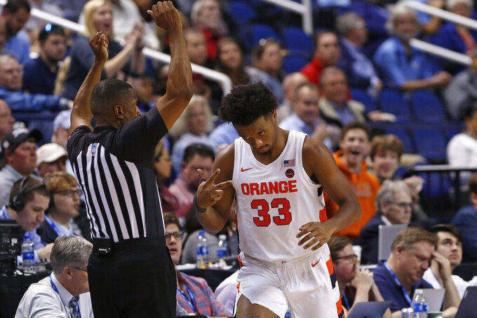 Syracuse forward Elijah Hughes (33) reacts follwing a three-point basket against North Carolina during the first half of an NCAA college basketball game at the Atlantic Coast Conference tournament in Greensboro, N.C., Wednesday, March 11, 2020. (AP Photo/Ben McKeown)