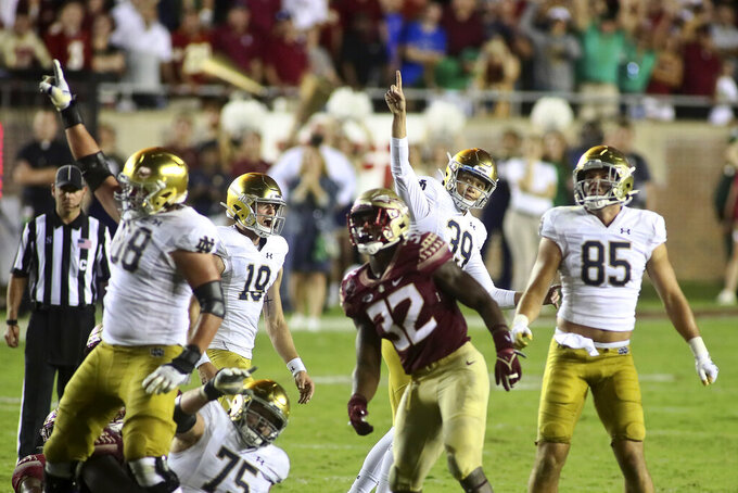 Notre Dame kicker Jonathan Doerer (39), right, and Notre Dame holder Jay Bramblett (19) react after making the game-winning field goal in overtime of an NCAA college football game against Florida State Sunday, Sept. 5, 2021, in Tallahassee, Fla. Notre Dame won 41-38. (AP Photo/Phil Sears)