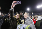 Purdue wide receiver Isaac Zico (7) takes a photo with fans after they rushed the field following a 49-20 win over Ohio State in an NCAA college football game in West Lafayette, Ind., Saturday, Oct. 20, 2018 (AP Photo/Michael Conroy)