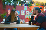 """This image released by Bleecker Street shows James McAvoy, right, and Sharon Horgan in a scene from """"Together."""" (Peter Mountain/Bleecker Street via AP)"""
