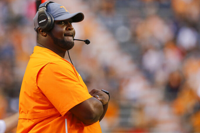 FILE - In this April 13, 2019, file photo, Tennessee assistant coach Tee Martin watchea the Orange and White NCAA college spring football game in Knoxville, Tenn. Tennessee's wide receivers savor the opportunity to play for their new position coach because they appreciate what Tee Martin accomplished during his own playing career. Martin was the starting quarterback on Tennessee's 1998 national championship team and is back at his alma mater trying to help the Volunteers become competitive again in the Southeastern Conference. (C.B. Schmelter/Chattanooga Times Free Press via AP, File)