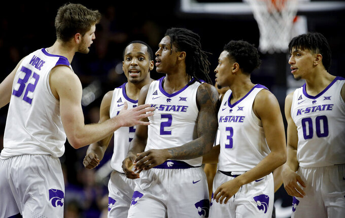 Teammates gather around Kansas State's Cartier Diarra (2) after he drew a foul during the second half of an NCAA college basketball game against Texas Tech Tuesday, Jan. 22, 2019, in Manhattan, Kan. Kansas State won 58-45. (AP Photo/Charlie Riedel)