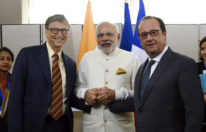 FILE - In this Sept. 28, 2015, file photo, from left, Microsoft CEO Bill Gates, and Indian Prime Minister Narendra Modi meet with French President Francois Hollande, as part of the 70th U.N. assembly in New York. Bill and Melinda Gates aren't backing down from honoring India Prime Minister Narendra Modi despite concerns about human rights abuses in the disputed Kashmir region. A group delivered 100,000 petition signatures to the Gates Foundation's Seattle headquarters Monday, Sept. 16, 2019, asking the world's largest private nonprofit not to honor Modi's sanitation initiative that improved access to toilets. (Alain Jocard/Pool Photo via AP, File)