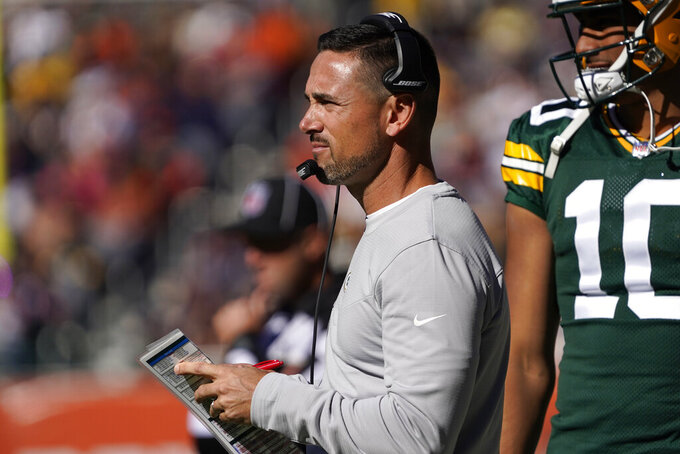 Green Bay Packers head coach Matt LaFleur watches from the sidelines during the second half of an NFL football game against the Chicago Bears Sunday, Oct. 17, 2021, in Chicago. (AP Photo/David Banks)