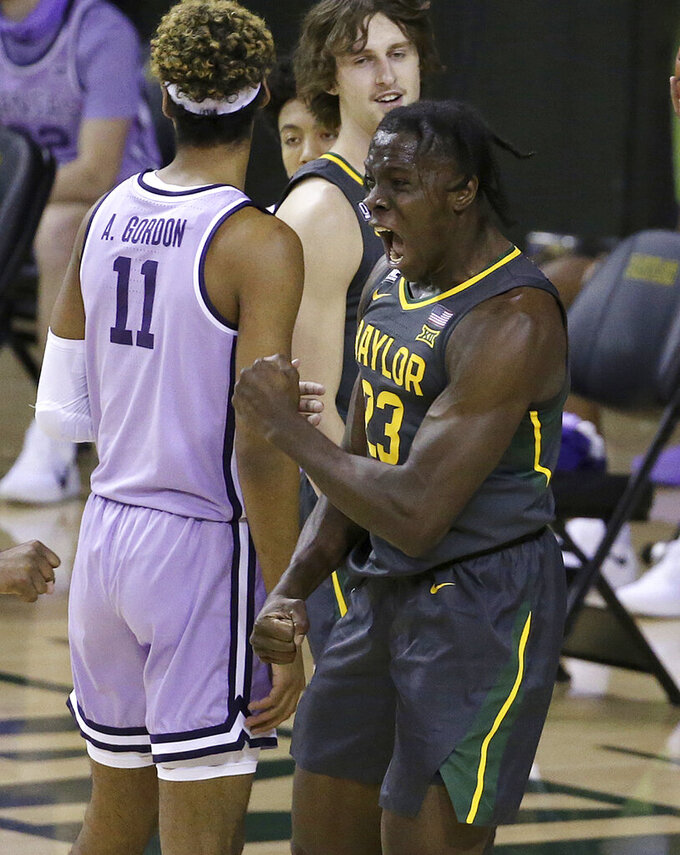 Baylor forward Jonathan Tchamwa Tchatchoua (23) reacts after scoring against Kansas State in the first half of an NCAA college basketball game, Wednesday, Jan. 27, 2021, in Waco, Texas. (AP Photo/Jerry Larson)