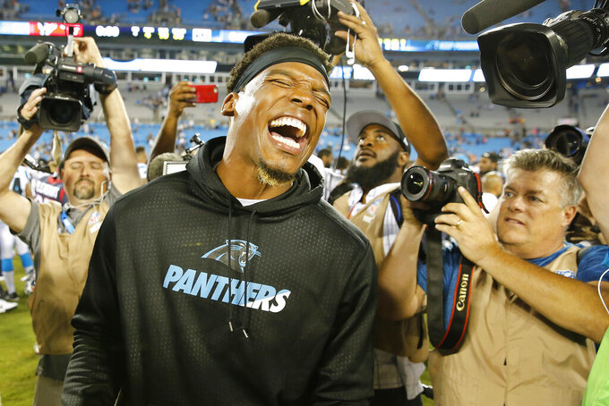 FILE - In this Aug. 9, 2017, file photo, Carolina Panthers quarterback Cam Newton laughs after the second half of an NFL preseason football game against the Houston Texans, in Charlotte, N.C. The Panthers are parting ways with Cam Newton. Carolina general manager Marty Hurney said Tuesday, March 17, 2020, via Twitter the team is giving the 31-year-old quarterback permission to seek a trade _ although the former league MVP responded by saying he never requested one. (AP Photo/Jason E. Miczek)