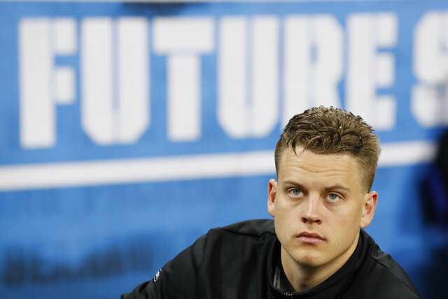 FILE - In this Feb. 27, 2020, file photo, LSU quarterback Joe Burrow watches a drill at the NFL football scouting combine in Indianapolis. No. 1 overall draft pick Joe Burrow acknowledged he had a little extra energy when he stepped on the practice field for his first walkthrough with the Cincinnati Bengals.  (AP Photo/Charlie Neibergall, File)
