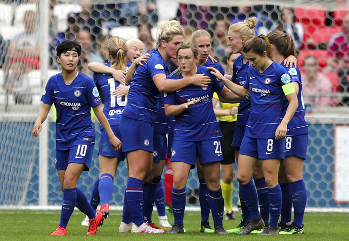 FILE - In this file photo dated Sunday, April 21, 2019, Chelsea's Erin Cuthbert, centre, and teammates celebrate scoring against Lyon during their Women's Champions League soccer match in Decines, France. The English Football Association's board have decided to determine the final standings on a points-per-game basis, Friday June 5, 2020, naming Chelsea as Women's Super League champions after the season was stopped because of the coronavirus pandemic. (AP Photo/Laurent Cipriani, FILE)