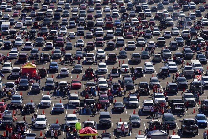 Fans tailgate outside Arrowhead Stadium before an NFL football game between the New York Jets and Kansas City Chiefs on Sunday, Nov. 1, 2020, in Kansas City, Mo. (AP Photo/Charlie Riedel)