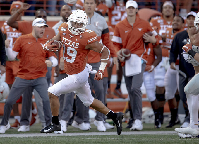Texas defensive back Brandon Jones (19) returns a punt against Kansas State during an NCAA college football game Saturday, Nov. 9, 2019, in Austin, Texas. (Nick Wagner/Austin American-Statesman via AP)