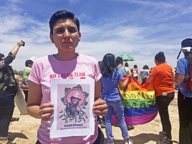 FILE - In this June 6, 2018, file photo, Gabriela Hernandez, executive director of the nonprofit New Mexico Dream Team, holds up an image in Albuquerque, N.M, of Roxsana Hernandez , a Honduran transgender woman who died while in U.S. custody. A transgender woman who has been detained with men in immigration custody for nine months says she's been sexually harassed and assaulted. Advocates say Alejandra Alor Reyes, an asylum-seeker from Mexico, is suffering from post-traumatic stress disorder and should be released on humanitarian grounds while she awaits an appeal to her asylum denial. They say transgender immigrants face unsafe conditions in detention and that none are being held with members of the gender they identify with. (AP Photo/Mary Hudetz, File)