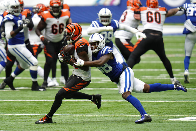 Cincinnati Bengals' A.J. Green (18) is tackled by Indianapolis Colts' T.J. Carrie (38) during the second half of an NFL football game, Sunday, Oct. 18, 2020, in Indianapolis. (AP Photo/AJ Mast)