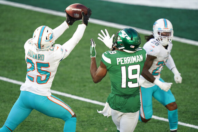 Miami Dolphins' Xavien Howard (25), left, breaks up a pass intended for New York Jets' Breshad Perriman (19) during the first half of an NFL football game, Sunday, Nov. 29, 2020, in East Rutherford, N.J. (AP Photo/Corey Sipkin)