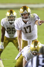 Notre Dame quarterback Jack Coan (17) motions in the third quarter of an NCAA college football game against Florida State Sunday, Sept. 5, 2021, in Tallahassee, Fla. (AP Photo/Phil Sears)