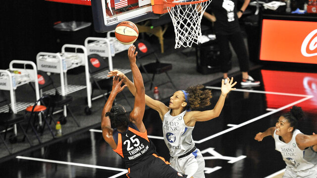 Connecticut Sun's Alyssa Thomas (25) shoots under pressure from Minnesota Lynx's Mikiah Herbert Harrigan during the first half of a WNBA basketball game Saturday, Aug. 1, 2020, in Bradenton, Fla. (AP Photo/Steve Nesius)