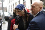 Model Lauren Marie Young arrives to testify at Harvey Weinstein's rape trial, Thursday, Feb. 6, 2020 in New York. (AP Photo/Mark Lennihan)