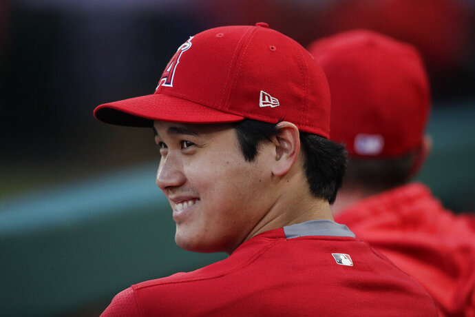 Los Angeles Angels' Shohei Ohtani, of Japan, smiles in the dugout before the team's baseball game against the Milwaukee Brewers, Wednesday, April 10, 2019, in Anaheim, Calif. (AP Photo/Jae C. Hong)