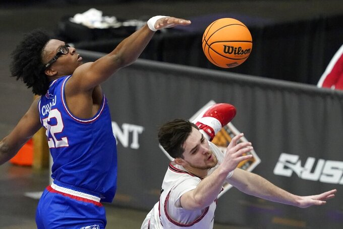 Louisiana Tech forward Isaiah Crawford (22) fouls Western Kentucky guard Luke Frampton on a shot attempt during the first half of an NCAA college basketball game in the quarterfinals of the NIT, Thursday, March 25, 2021, in Frisco, Texas. (AP Photo/Tony Gutierrez)