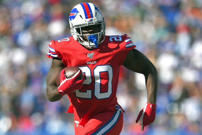 FILE - In this Oct. 20, 2019, file photo, Buffalo Bills running back Frank Gore runs against the Miami Dolphins in the second half of an NFL football game in Orchard Park, N.Y. Gore just turned 37, absolutely ancient by NFL running back standards. Entering his first season with the Jets, Gore is feeling fresh and ready to help carry the load with Le'Veon Bell in New York's backfield. (AP Photo/Adrian Kraus, File)