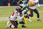 Tampa Bay Buccaneers' Shaquil Barrett (58) sacks Green Bay Packers quarterback Aaron Rodgers (12) during the first half of the NFC championship NFL football game in Green Bay, Wis., Sunday, Jan. 24, 2021. (AP Photo/Jeffrey Phelps)