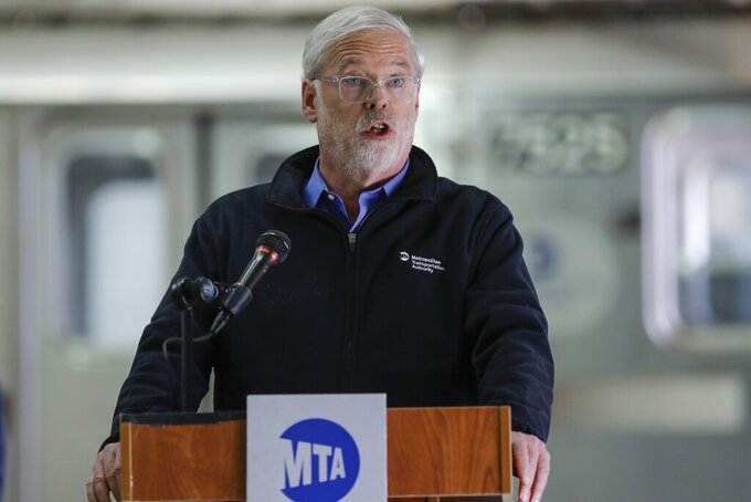 FILE - In this Tuesday, May 19, 2020, file photo, Metropolitan Transportation Authority chairman and CEO Patrick Foye speaks during a news conference on new measures involving UV-C light technology to disinfect trains and buses during the coronavirus pandemic, in New York. New York's mass transit agency wants Apple to come up with a better way for iPhone users to unlock their phones without taking off their masks, as it seeks to guard against the spread of COVID-19 in buses and subways. (AP Photo/Frank Franklin II, File)