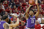 Northwestern's Anthony Gaines (11) shoots against Nebraska's James Palmer Jr., left, during the first half of an NCAA college basketball game in Lincoln, Neb., Saturday, Feb. 16, 2019. (AP Photo/Nati Harnik)