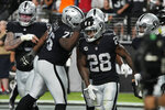 Las Vegas Raiders running back Josh Jacobs (28) celebrates after scoring a touchdown against the Baltimore Ravens during the second half of an NFL football game, Monday, Sept. 13, 2021, in Las Vegas. (AP Photo/Rick Scuteri)